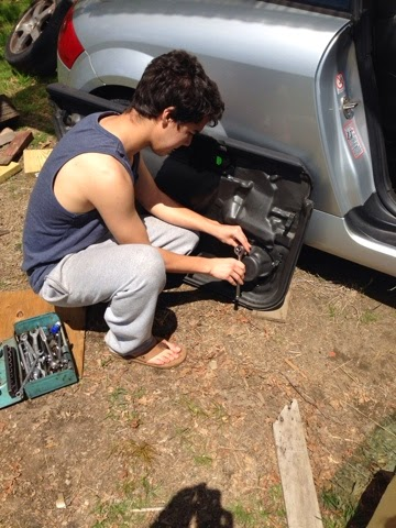 Christopher '14  works on his electric Audi TT. http://evauditt.blogspot.com/